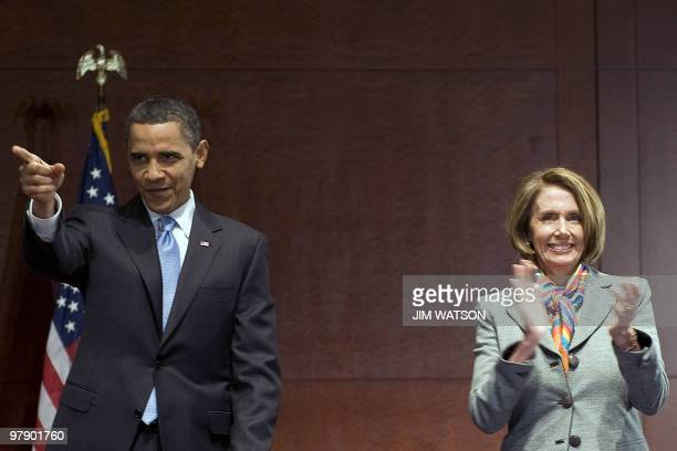 US President Barack Obama speaks with Speaker of the House Nancy Pelosi as he arrives to meet with members of the House Democratic Caucus at the US...