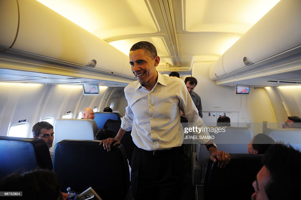 US President Barack Obama speaks with traveling journalists on board Air Force One on April 28, 2010. Obama met more Americans yet to feel the nascent economic recovery, on a heartland tour to fire up the Democratic campaign to avoid a drubbing in November's mid-term elections. AFP PHOTO/Jewel Samad