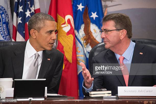 US President Barack Obama speaks with US Secretary of Defense Ashton Carter during a National Security Council meeting on the campaign against ISIL...