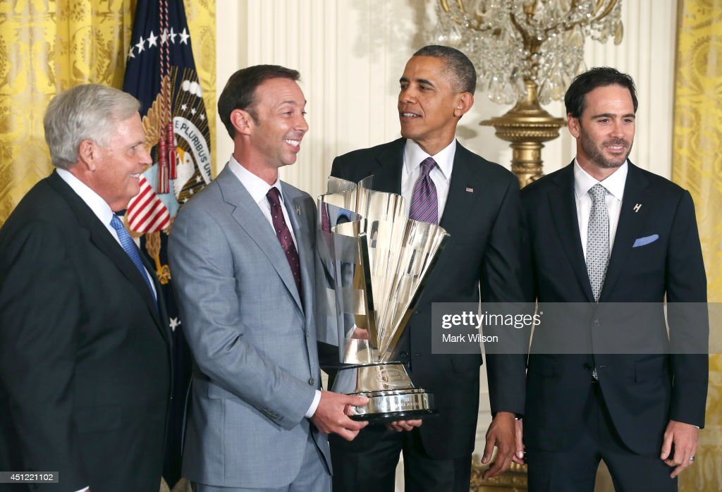 U.S. President <a gi-track='captionPersonalityLinkClicked' href=/galleries/search?phrase=Barack+Obama&family=editorial&specificpeople=203260 ng-click='$event.stopPropagation()'>Barack Obama</a> (2ndR) stand with the 2013 NASCAR Sprint Cup Series Champion Jimmie Johnson (R), team owner <a gi-track='captionPersonalityLinkClicked' href=/galleries/search?phrase=Rick+Hendrick&family=editorial&specificpeople=596436 ng-click='$event.stopPropagation()'>Rick Hendrick</a> ( L), crew chief <a gi-track='captionPersonalityLinkClicked' href=/galleries/search?phrase=Chad+Knaus&family=editorial&specificpeople=564401 ng-click='$event.stopPropagation()'>Chad Knaus</a> (2nd L), during an event in the East Room of the White House on June 25, 2014 in Washington, DC. Johnson was honored for winning his 6th Sprint Cup championship.