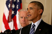 President Barack Obama standing with Vice President Joe Biden conducts a press conference in the East Room of the White House in response to the Iran...