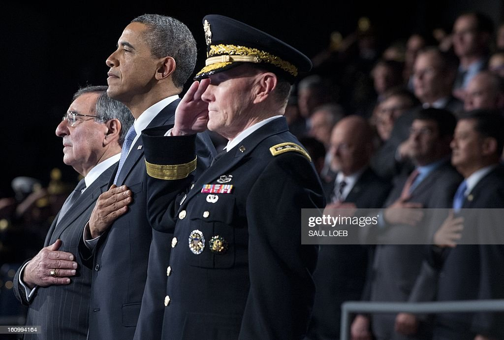 US President Barack Obama (C) stands alongside outgoing Defense Secretary Leon Panetta (L) and Chairman of the Joint Chiefs of Staff Martin Dempsey (R) during the National Anthem as part of an Armed Forces Farewell Tribute in honor of Panetta at Joint Base Myer-Henderson in Arlington, Virginia, February 8, 2013. Panetta will retire once his likely successor, former Nebraska Senator Chuck Hagel, is confirmed by the US Senate. AFP PHOTO / Saul LOEB