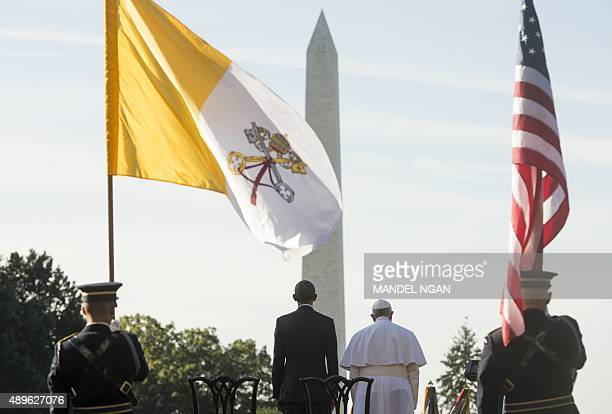 US President Barack Obama stands alongside Pope Francis during an arrival ceremony on the South Lawn of the White House in Washington DC September 23...