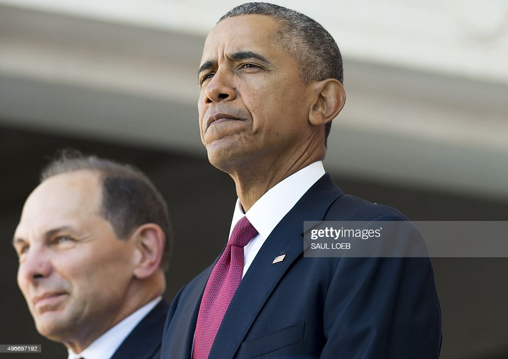US President Barack Obama stands alongside Secretary of Veterans Affairs Bob McDonald during a ceremony in honor of Veteran's Day at Arlington...