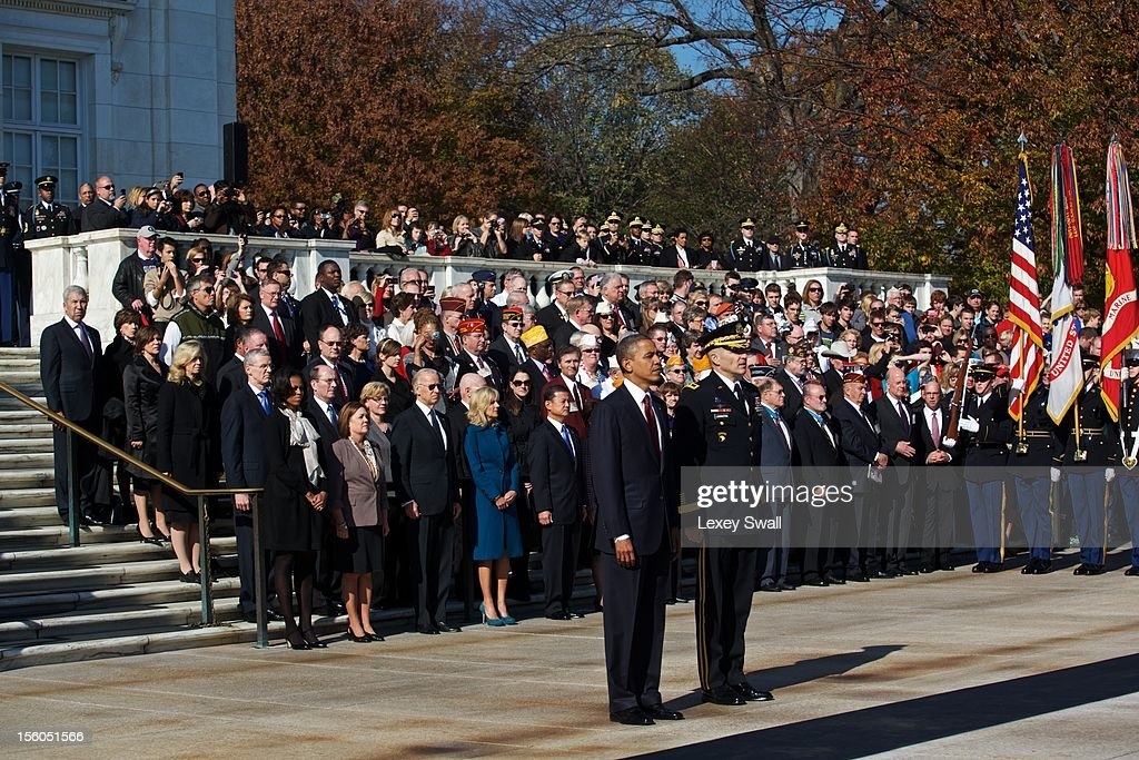 U.S. President Barack Obama stands before the Tomb of the Unknowns with Major General Michael S. Linnington during the Presidential Wreath-Laying Ceremony at Arlington National Cemetery on November 11, 2012 Arlington, Virginia. Obama delivered remarks at the cemetery amphitheater after laying the wreath.