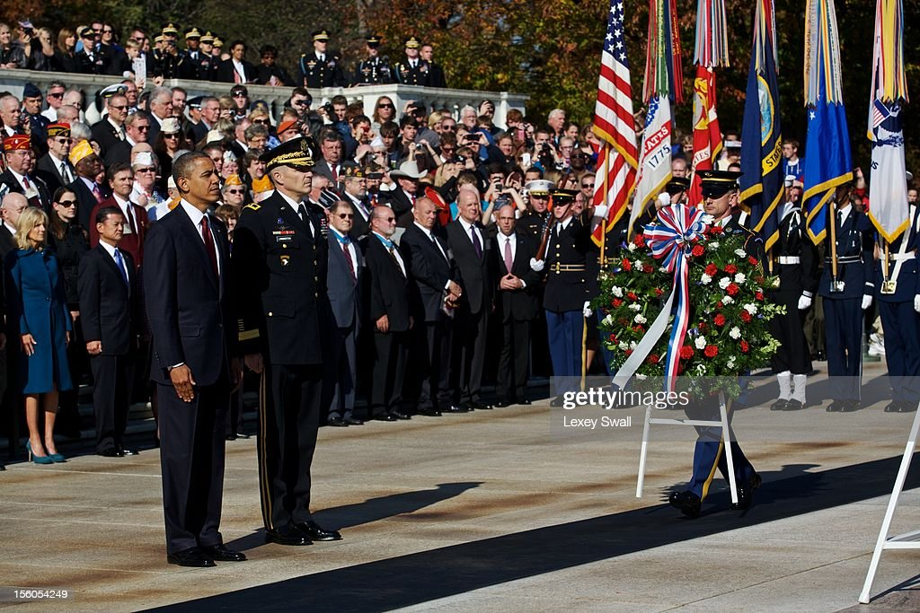 U.S. President Barack Obama stands before the Tomb of the Unknowns with Maj. Gen. Michael Linnington during the Presidential Wreath-Laying Ceremony on Veteran's Day at Arlington National Cemetery on November 11, 2012 in Arlington, Virginia. Numerous events are under across the country to honor the nation's current and former service members.