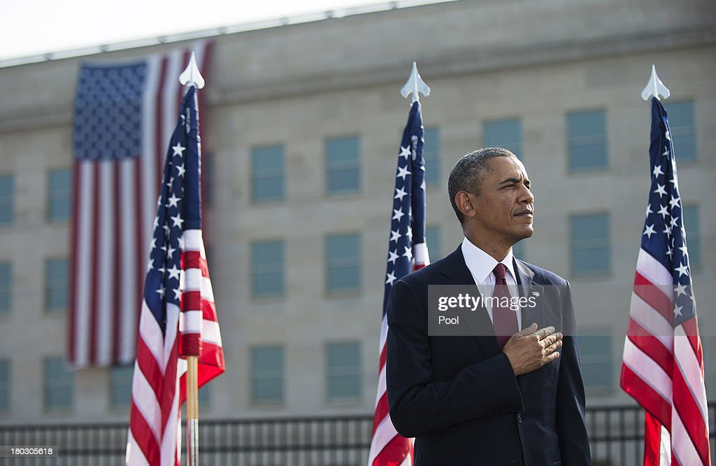 S. President <a gi-track='captionPersonalityLinkClicked' href=/galleries/search?phrase=Barack+Obama&family=editorial&specificpeople=203260 ng-click='$event.stopPropagation()'>Barack Obama</a> stands during a ceremony in observance of the terrorist attacks of 9/11 at the Pentagon September 11, 2013 in Arlington, Virginia. Family members of the Pentagon attack victims and survivors of the attack gathered to hear from Obama and other leaders at the National 9/11 Pentagon Memorial near the place where terrorists drove a jetliner into the Department of Defense headquarters in 2001.