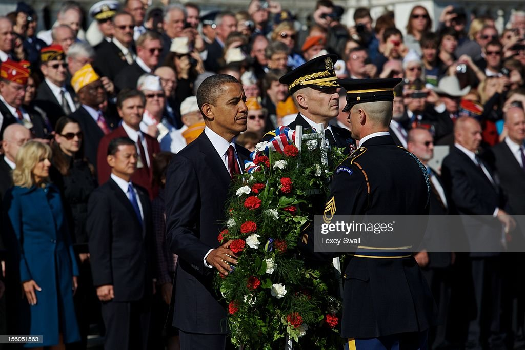 U.S. President Barack Obama stands next to Major General Michael S. Linnington as he prepares to lay the wreath in front of the Tomb of the Unknowns during the Presidential Wreath-Laying Ceremony at Arlington National Cemetery on November 11, 2012 Arlington, Virginia. Obama delivered remarks at the cemetery amphitheater after laying the wreath.
