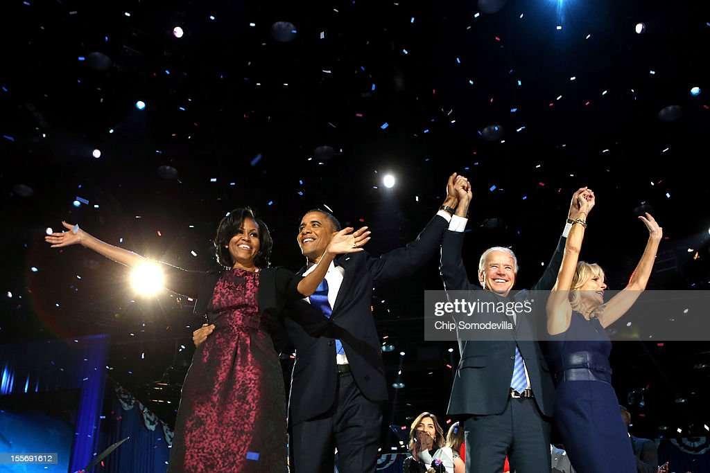 U.S. President Barack Obama stands on stage with first lady Michelle Obama, U.S. Vice President Joe Biden and Dr. Jill Biden after his victory speech on election night at McCormick Place November 6, 2012 in Chicago, Illinois. Obama won reelection against Republican candidate, former Massachusetts Governor Mitt Romney.