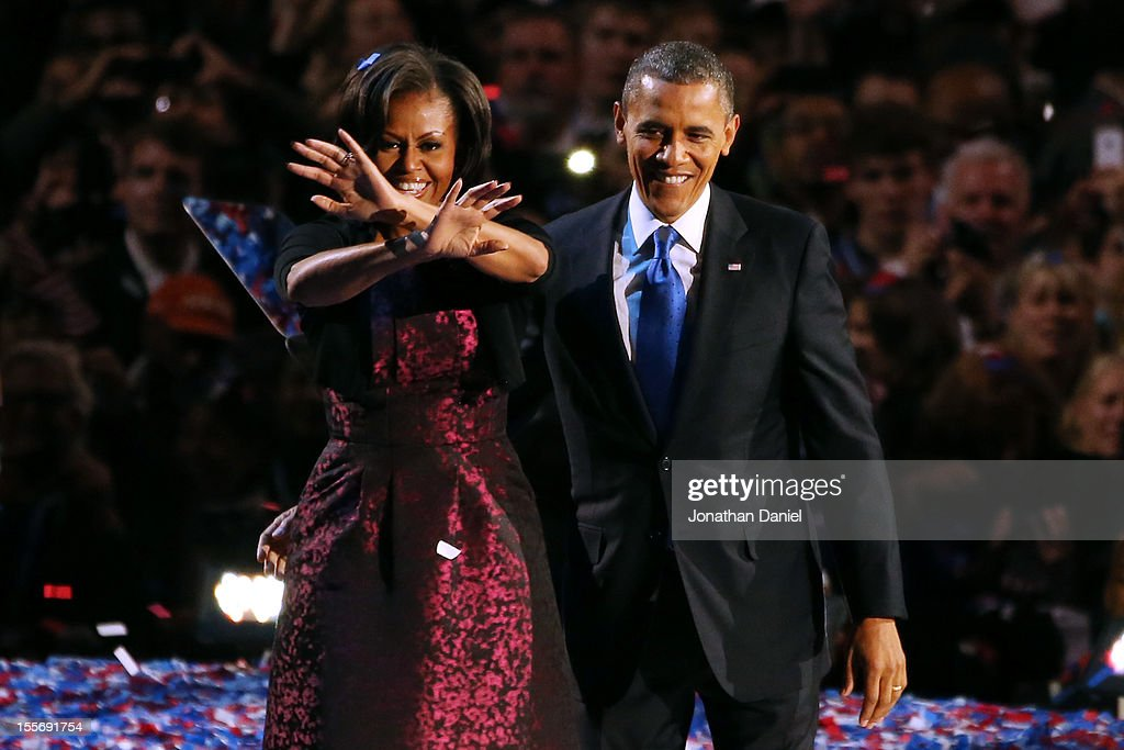 U.S. President <a gi-track='captionPersonalityLinkClicked' href=/galleries/search?phrase=Barack+Obama&family=editorial&specificpeople=203260 ng-click='$event.stopPropagation()'>Barack Obama</a> stands on stage with first lady <a gi-track='captionPersonalityLinkClicked' href=/galleries/search?phrase=Michelle+Obama&family=editorial&specificpeople=2528864 ng-click='$event.stopPropagation()'>Michelle Obama</a> after his victory speech on election night at McCormick Place November 6, 2012 in Chicago, Illinois. Obama won reelection against Republican candidate, former Massachusetts Governor Mitt Romney.