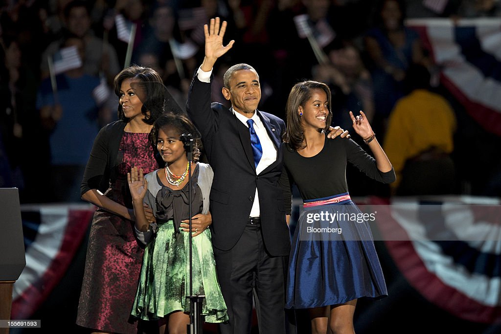 U.S. President Barack Obama stands on stage with his wife Michelle Obama, left, and daughters Sasha, second left, and Malia, right, before making an acceptance speech during an election night rally in Chicago, Illinois, U.S., in the early morning on Wednesday, Nov. 7, 2012. Obama, the post-partisan candidate of hope who became the first black U.S. president, won re-election today by overcoming four years of economic discontent with a mix of political populism and electoral math. Photographer: Daniel Acker/Bloomberg via Getty Images