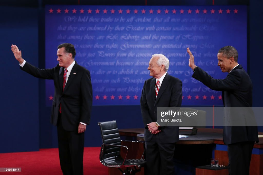 S President Barack Obama stands on stage with Republican presidential candidate Mitt Romney and moderator Bob Schieffer of CBS at the Keith C and...
