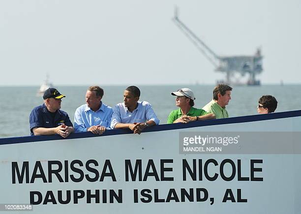 US President Barack Obama stands on the deck of a ferry as he travels from Dauphin Island Alabama to Fort Morgan Alabama June 14 2010 Seen in the...