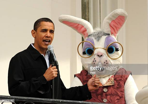 US President Barack Obama stands with a costumed Easter Bunny as he welcomes people to the annual White House Easter Egg Roll on the South Lawn of...