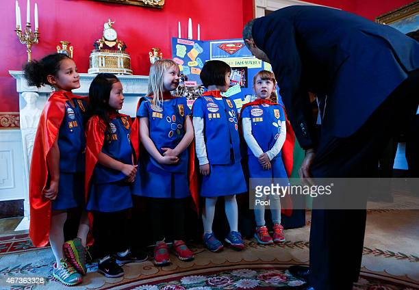 S President Barack Obama stands with a group of sixyearold Girls Scouts from Tulsa Oklahoma who designed a battery powered page turner to help people...