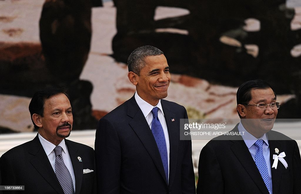 US President Barack Obama (C) stands with Association of Southeast Asian Nations (ASEAN) leaders including Brunei's Sultan Hassanal Bolkiah (L) and Cambodian Prime Minister Hun Sen (R) during a family picture ahead of the 7th East Asia Summit in Phnom-Penh on November 20, 2012. US President Barack Obama was set to dive into the tumultuous diplomatic waters of the South China Sea at a summit dominated by rival claims to the strategically vital area. AFP PHOTO/Christophe ARCHAMBAULT