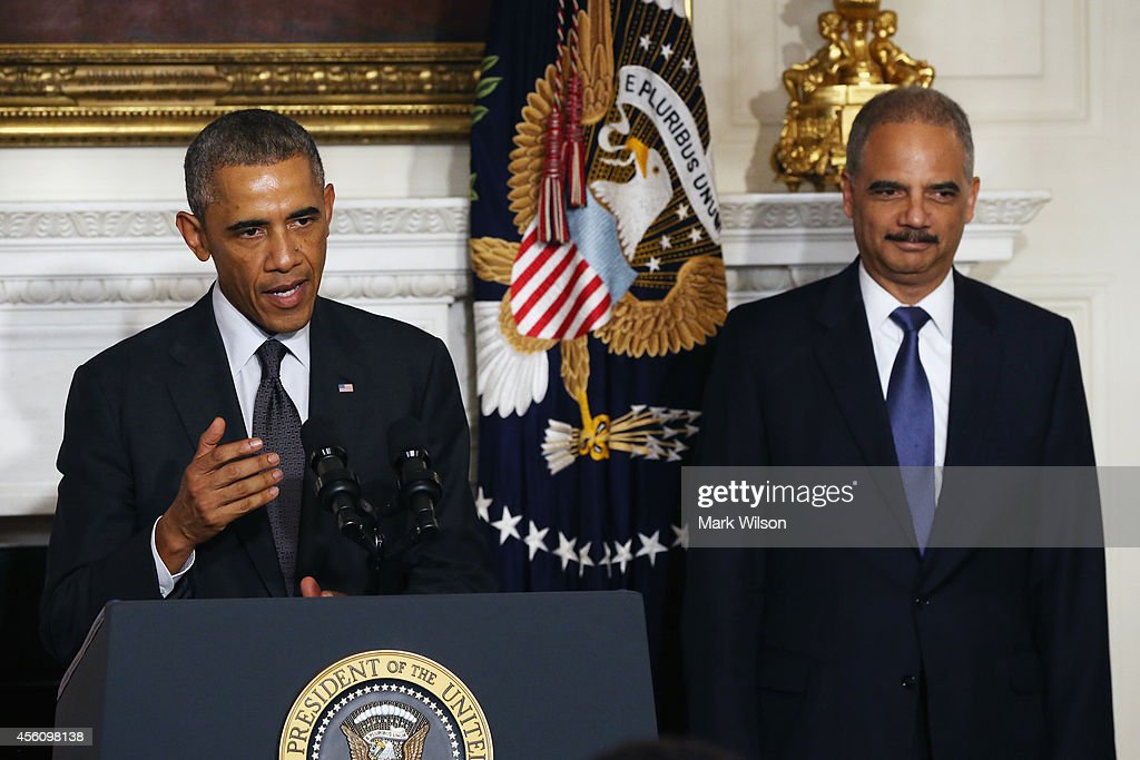 US President Barack Obama stands with Attorney General Eric H. Holder Jr. who announced his resignation today, September 25, 2014 in Washington, DC. President Obama said that Mr. Holder will remain in office until a successor is nominated and confirmed.
