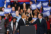 S President Barack Obama stands with Connecticut Governor Dan Malloy as he speaks in support of Malloy on November 2 2014 in Bridgeport Connecticut...