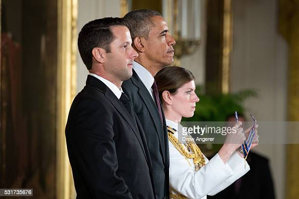 S President Barack Obama stands with Federal Bureau of Investigation Special Agent Tyler Call before presenting him the Medal of Valor during a...