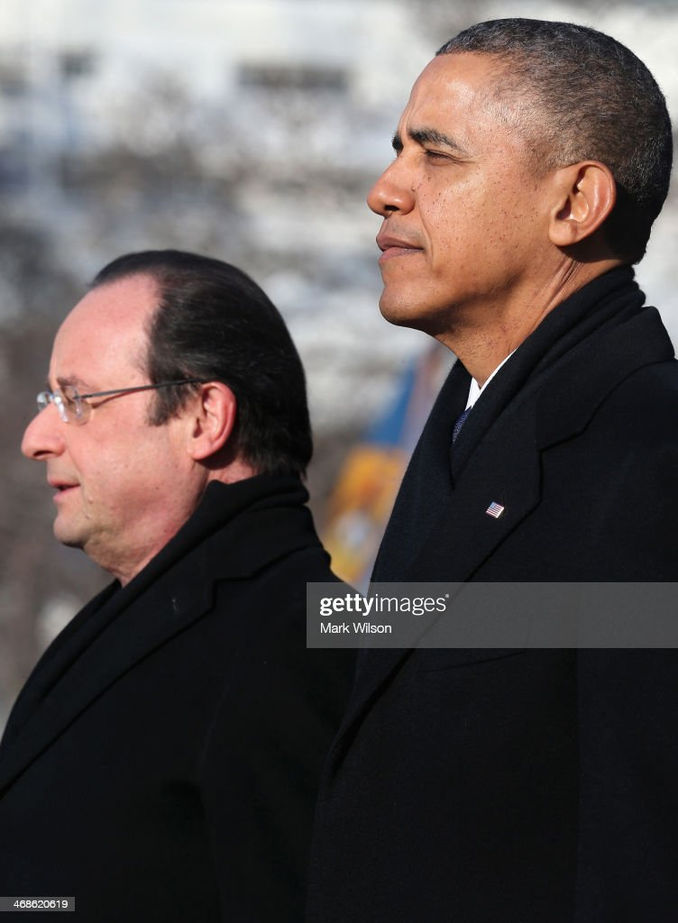 U.S. President <a gi-track='captionPersonalityLinkClicked' href=/galleries/search?phrase=Barack+Obama&family=editorial&specificpeople=203260 ng-click='$event.stopPropagation()'>Barack Obama</a> (R) stands with French President Francois Hollande for the national anthem during a welcoming ceremony on the South Lawn at the White House on February 11, 2014 in Washington, DC. Hollande who arrived yesterday for a three day state visit, visited Thomas Jefferson's Monticello estate and will be the guest of honor for a state dinner tonight.