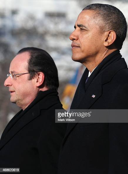 S President Barack Obama stands with French President Francois Hollande for the national anthem during a welcoming ceremony on the South Lawn at the...