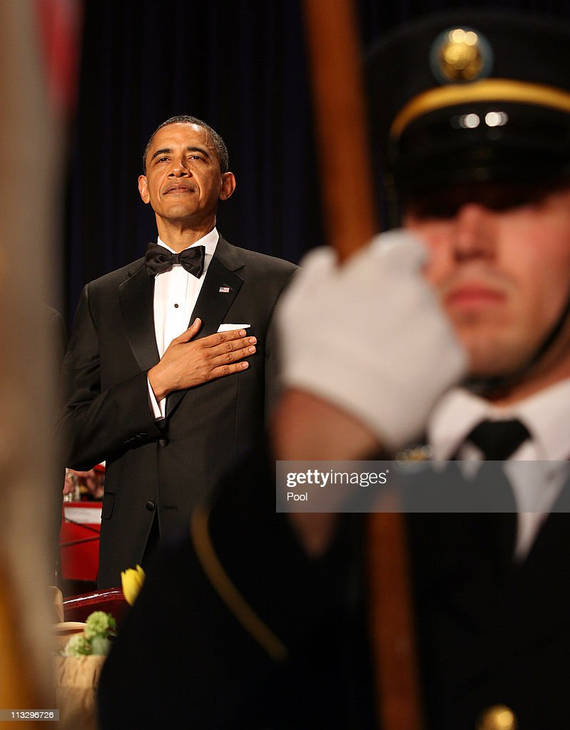 US President <a gi-track='captionPersonalityLinkClicked' href=/galleries/search?phrase=Barack+Obama&family=editorial&specificpeople=203260 ng-click='$event.stopPropagation()'>Barack Obama</a> stands with his hand over his heart during the pledge of allegience at the start of the annual White House Correspondent's Association Gala at the Washington Hilton hotel April 30, 2011 in Washington, DC.