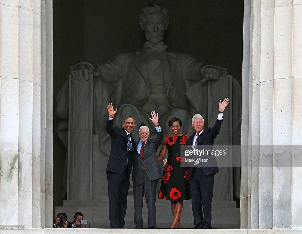 President Barack Obama (L) stands with his wife Michelle Obama (2nd-R) and former presidents Jimmy Carter (2nd-L) and Bill Clinton during the ceremony to commemorate the 50th anniversary of the March on Washington for Jobs and Freedom August 28, 2013 in Washington, DC. It was 50 years ago today that Martin Luther King, Jr. delivered his 'I Have A Dream Speech' on the steps of the Lincoln Memorial.