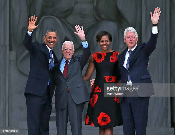 President Barack Obama stands with his wife Michelle Obama and former presidents Jimmy Carter and Bill Clinton during the ceremony to commemorate the...