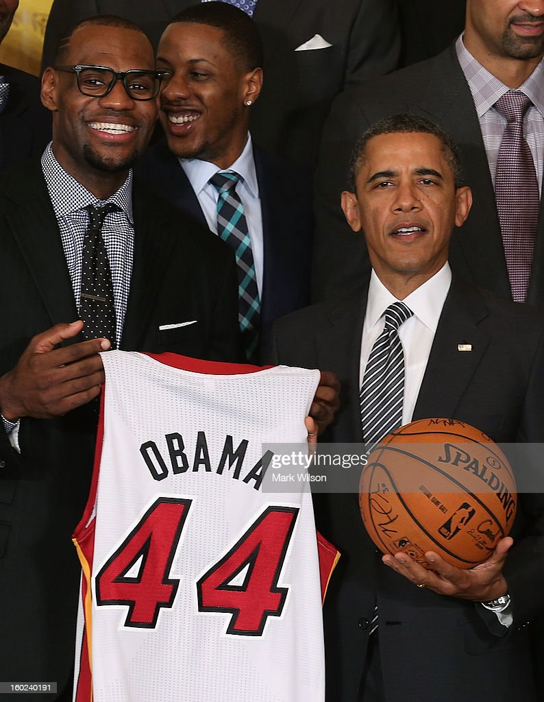 U.S. President Barack Obama (R) stands with LeBron James (L) during an event to honor the NBA champion Miami Heat in the East Room at the White House on January 28, 2013 in Washington, DC. President Barack Obama congratulated the 2012 NBA champions for claiming their third NBA Championship by beating the Boston Celtics.