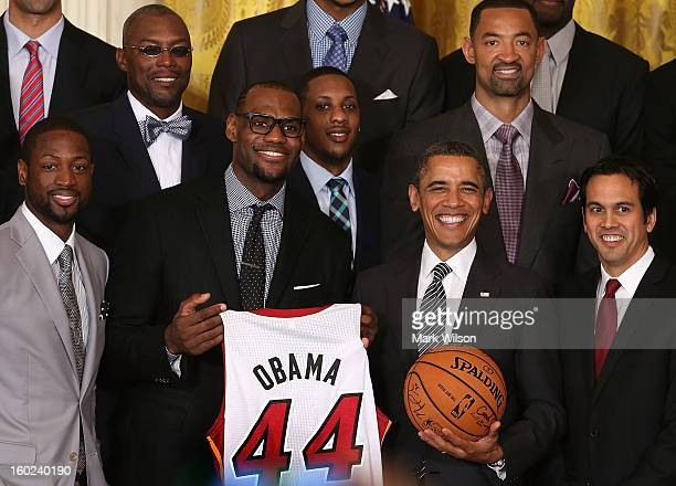 S President Barack Obama stands with Miami Heat players including Dwyane Wade LeBron James Mario Chalmers and Head coach Erik Spoelstra during an...
