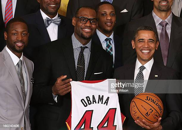 S President Barack Obama stands with Miami Heat players including Dwyane Wade LeBron James Mario Chalmers during an event to honor the NBA champion...