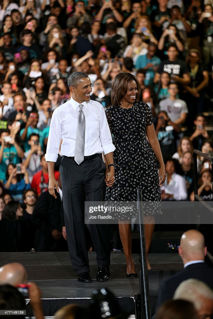 U.S. President Barack Obama stands with Michelle Obama after speaking during an event at Coral Reef Senior High on March 7, 2014 in Miami, Florida. Obama announced a program that will allow students an easier way to complete the Free Application for Federal Student Aid.