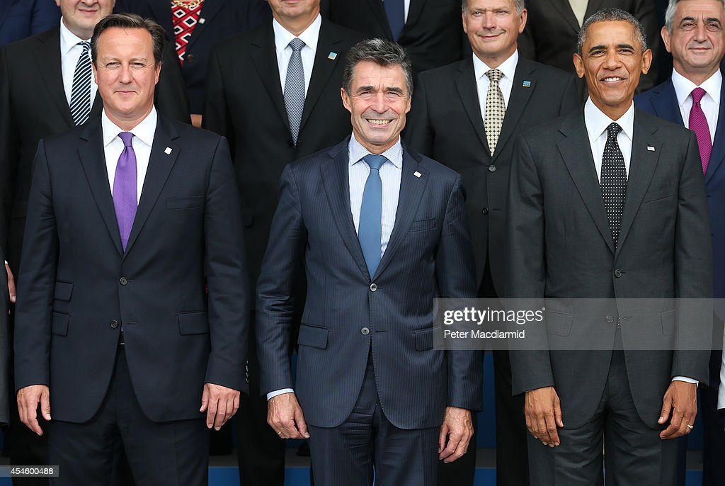 US President <a gi-track='captionPersonalityLinkClicked' href=/galleries/search?phrase=Barack+Obama&family=editorial&specificpeople=203260 ng-click='$event.stopPropagation()'>Barack Obama</a> (R) stands with NATO Secretary General <a gi-track='captionPersonalityLinkClicked' href=/galleries/search?phrase=Anders+Fogh+Rasmussen&family=editorial&specificpeople=549374 ng-click='$event.stopPropagation()'>Anders Fogh Rasmussen</a> (C) and British Prime Minister <a gi-track='captionPersonalityLinkClicked' href=/galleries/search?phrase=David+Cameron+-+Homme+politique&family=editorial&specificpeople=227076 ng-click='$event.stopPropagation()'>David Cameron</a> at the NATO Summit on September 4, 2014 in Newport, Wales. Leaders and senior ministers from around 60 countries are gathering for the two day meeting where Ukraine and the ISIS hostages are likely to be discussed.