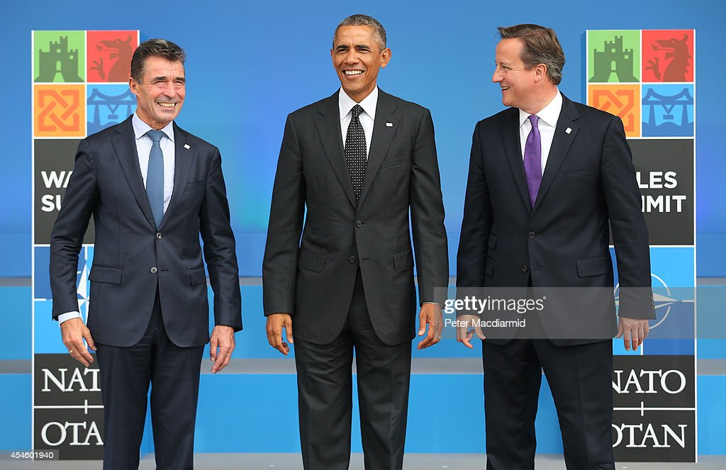 US President <a gi-track='captionPersonalityLinkClicked' href=/galleries/search?phrase=Barack+Obama&family=editorial&specificpeople=203260 ng-click='$event.stopPropagation()'>Barack Obama</a> (C) stands with NATO Secretary General <a gi-track='captionPersonalityLinkClicked' href=/galleries/search?phrase=Anders+Fogh+Rasmussen&family=editorial&specificpeople=549374 ng-click='$event.stopPropagation()'>Anders Fogh Rasmussen</a> (L) and British Prime Minister <a gi-track='captionPersonalityLinkClicked' href=/galleries/search?phrase=David+Cameron+-+Homme+politique&family=editorial&specificpeople=227076 ng-click='$event.stopPropagation()'>David Cameron</a> at the NATO Summit on September 4, 2014 in Newport, Wales. Leaders and senior ministers from around 60 countries are meeting at what has been billed as the most important Nato summit since the end of the cold war with the situation in Ukraine and the threat of ISIS likely to be top of the agenda.