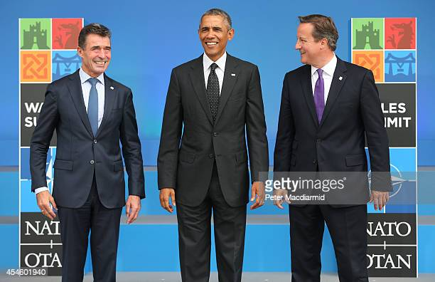 President Barack Obama stands with NATO Secretary General Anders Fogh Rasmussen and British Prime Minister David Cameron at the NATO Summit on...