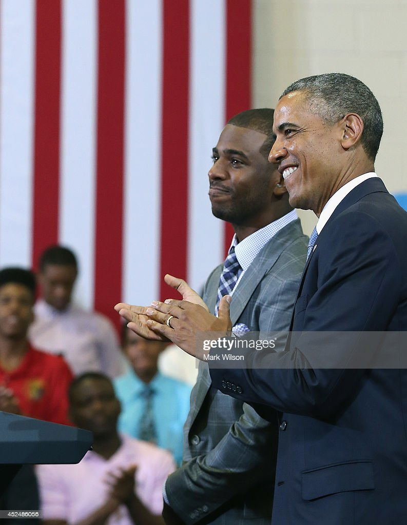 U.S. President <a gi-track='captionPersonalityLinkClicked' href=/galleries/search?phrase=Barack+Obama&family=editorial&specificpeople=203260 ng-click='$event.stopPropagation()'>Barack Obama</a> (R) stands with NBA Basketball player <a gi-track='captionPersonalityLinkClicked' href=/galleries/search?phrase=Chris+Paul&family=editorial&specificpeople=212762 ng-click='$event.stopPropagation()'>Chris Paul</a> of the Los Angeles Clippers during an event at the Walker Jones Education Campus, on July 21, 2014 in Washington, DC. President Obama spoke to area youth about My Brothers Keeper Initiative during a town hall meeting.