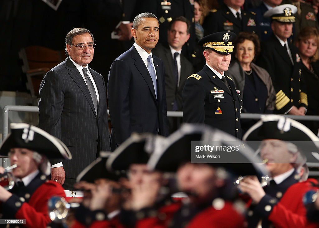U.S. President <a gi-track='captionPersonalityLinkClicked' href=/galleries/search?phrase=Barack+Obama&family=editorial&specificpeople=203260 ng-click='$event.stopPropagation()'>Barack Obama</a> (C) stands with Secretary of Defense Leon Panetta (L) and U.S. Army General Martin E. Dempsey, chairman of the Joint Chiefs of Staff, during an Armed Service farewell ceremony for Sec. Panetta at Joint Base Ft. Myer, on February 8, 2013 in Arlington, Virginia. If confirmed by the U.S. Senate former U.S. Senator Chuck Hagel (R-NE) will replace Panetta as Defense Secretary.