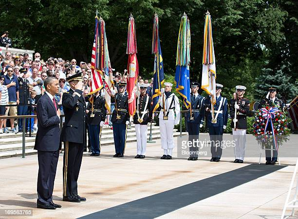 US President Barack Obama stands with US Army General Michael Linnington commander of the Military District of Washington during a wreath laying at...