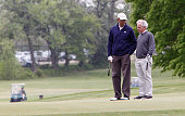 US President Barack Obama stands with US Sen Bob Corker as he plays golf with some Senators May 6 2013 at Joint Base Andrews Maryland Obama played...