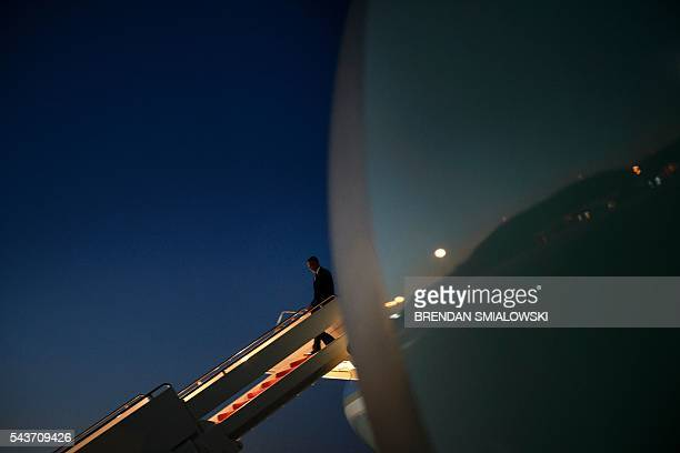 President Barack Obama steps off Air Force One at Andrews Air Force Base June 29 2016 in Maryland upon his return from Ottawa Canada where he...
