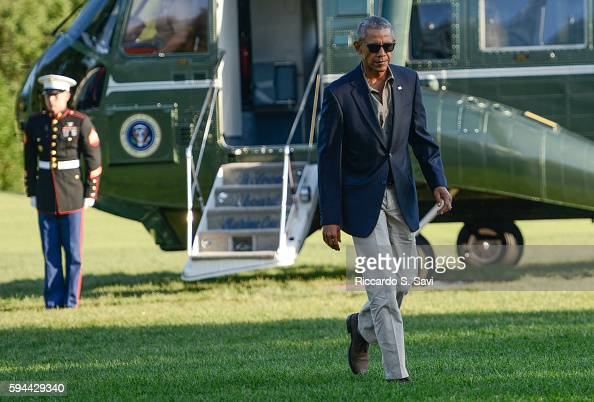 President Barack Obama steps off Marine One after returning to the White House from Baton Rouge Louisiana on August 23 2016 in Washington DC