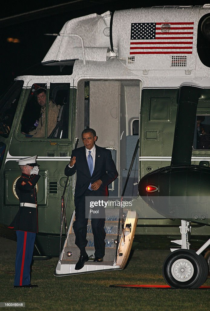 U.S. President <a gi-track='captionPersonalityLinkClicked' href=/galleries/search?phrase=Barack+Obama&family=editorial&specificpeople=203260 ng-click='$event.stopPropagation()'>Barack Obama</a> steps off of Marine One onto the South Lawn of the White House on January 29, 2013 in Washington, D.C.The president was returning from a day-trip to Las Vegas, NV where he spoke on immigration reform.