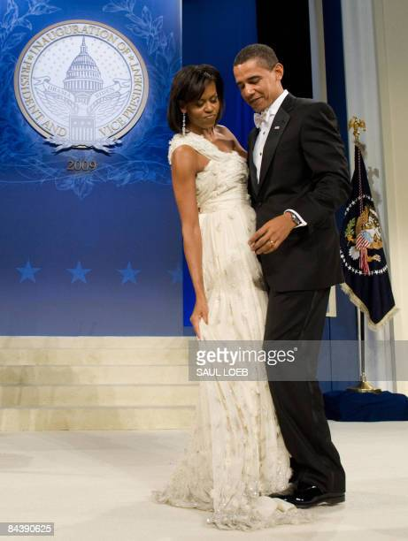 US President Barack Obama steps on First Lady Michelle Obama's dress during the Obama Home States Inaugural Ball at the Washington Convention Center...