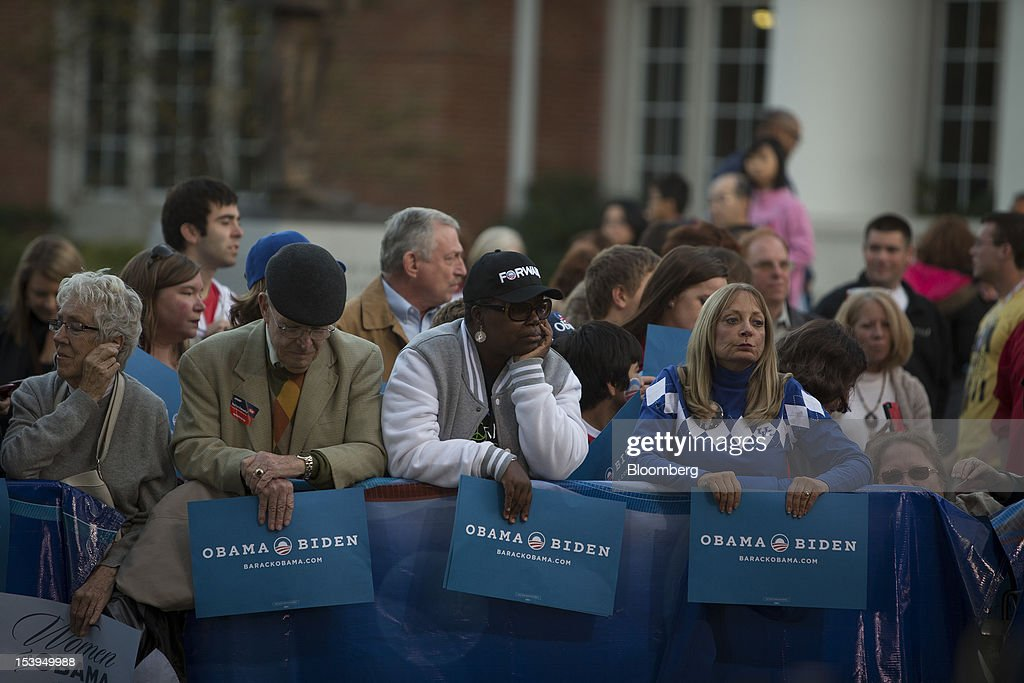 U.S. President Barack Obama supporters wait to watch the filming of a television show before the start of a debate in Danville, Kentucky, U.S., on Thursday, Oct. 11, 2012. The vice presidential debate at Centre College in Danville, Kentucky, has taken on greater significance after a majority of voters said President Barack Obama lost to former Massachusetts Governor Mitt Romney in their first showdown on Oct. 3. Romney has surged in national and state polls. Photographer: Scott Eells/Bloomberg via Getty Images