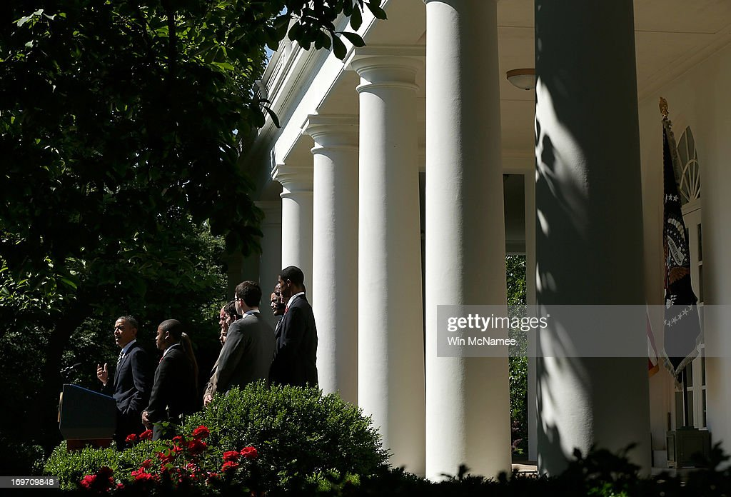 U.S. President <a gi-track='captionPersonalityLinkClicked' href=/galleries/search?phrase=Barack+Obama&family=editorial&specificpeople=203260 ng-click='$event.stopPropagation()'>Barack Obama</a> (L), surrounded by college students, makes a statement on student loans in the Rose Garden of the White House May 31, 2013 in Washington, DC. Obama made existing student loan programs an issue during his campaign last year while visiting many college campuses across the U