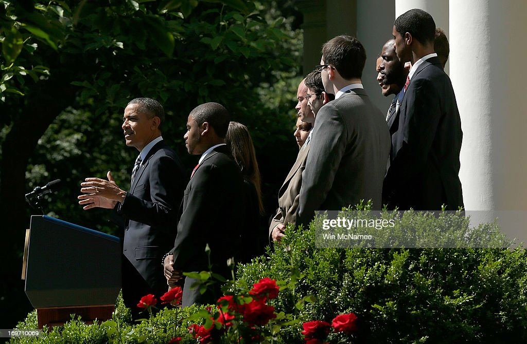 U.S. President <a gi-track='captionPersonalityLinkClicked' href=/galleries/search?phrase=Barack+Obama&family=editorial&specificpeople=203260 ng-click='$event.stopPropagation()'>Barack Obama</a> (L), surrounded by college students, makes a statement on student loans in the Rose Garden of the White House May 31, 2013 in Washington, DC. Obama made existing student loan programs an issue during his campaign last year while visiting many college campuses across the U.S..