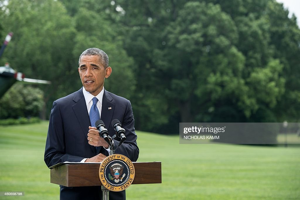 US President Barack Obama takes a question as he makes a statement on the situation in Iraq on the South Lawn of the White House in Washington on June 13, 2014. Obama said Friday that he is examining options short of sending ground troops to help Iraq counter a Sunni extremist offensive, but warned the country must heal its own divisions. 'We will not be sending US troops back into combat in Iraq, but I have asked my national security team to prepare a range of other options that could help support Iraqi security forces,' Obama said. AFP PHOTO/Nicholas KAMM