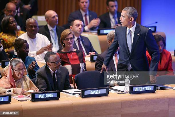 US President Barack Obama takes his seat next to Rwandan President Paul Kagame and Bangladesh Prime Minister Sheikh Hasina after delivering remarks...