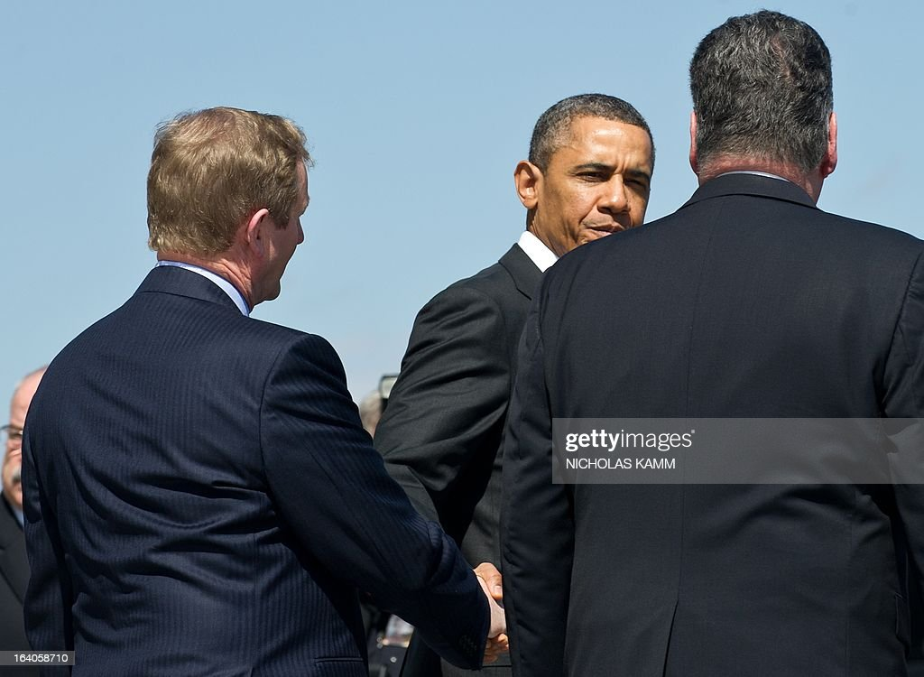US President <a gi-track='captionPersonalityLinkClicked' href=/galleries/search?phrase=Barack+Obama&family=editorial&specificpeople=203260 ng-click='$event.stopPropagation()'>Barack Obama</a> takes leaves of Irish Prime Minister Enda Kenny (L) and Rep. Peter King of New York as he leaves the US Capitol after the Friends of Ireland luncheon in Washington on March 19, 2013. AFP PHOTO/Nicholas KAMM