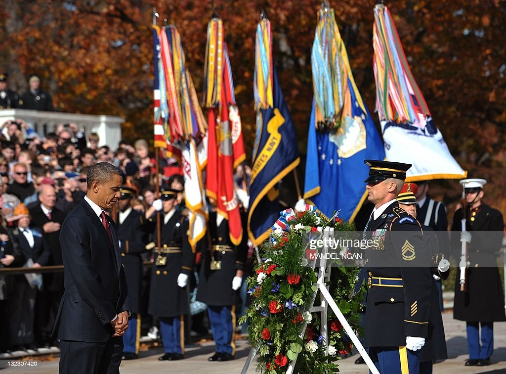 US President Barack Obama takes part in a wreathlaying ceremony at the Tomb of the Unknown Soldier on Veterans Day on November 11 2011 at Arlington...